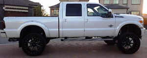 "2015 Ford F-350 Platinum with 8"" Fabtech Lift & 24"" Fuel Rims"