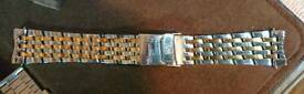 Stainless steel and gold watch bracelet 22 mm. Would suit Breitling Navitimer