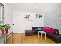 Leather corner sofa, silver side tables, white shelving unit