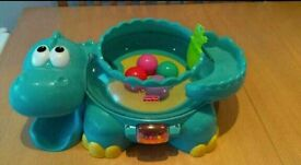 Fisher Price Go baby go poppity posted musician dino