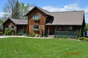 WATERFRONT! CUSTOM BUILT LOG HOME WITH INLAW!