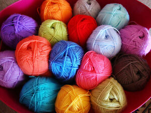 WANTED:   Yarn to make scarves and toques to donate