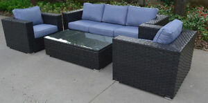 Outdoor wicker sofa and two armchairs with coffee table