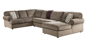 One yearr New ASHLEY Couches Sectional +Chaise on right