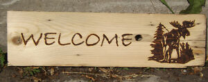 HANDCRAFTED WOODBURNED WELCOME SIGN WITH MOOSE AND PINE