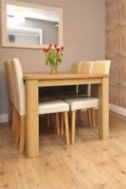 Dining table and 6 cream leather chairs.