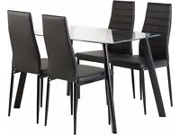 Really nice Brand New dining table and 4 chairs, clear glass/ metal/ black faux leather.can deliver
