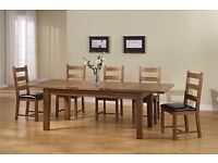 Solid oak extendable table and six chairs