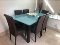 Calligaris extendable glass dining table and brown leather chairs