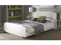 White faux leather bed kingsize