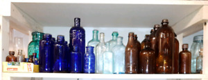 antique collection of glass jars and bottles