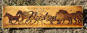 "HANDMADE WOODBURNING SIGN ""IN RIDING A HORSE WE BORROW FREEDOM"""