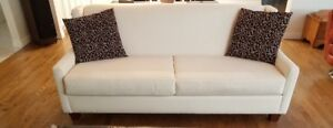 Pristine cream colored tight back sofa