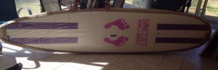 SUP board Barefoot Designs with paddle