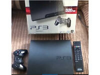 PS3 boxed with games and media remote