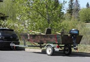 12 ft Jon Boat, 7.5 hp Mercury outboard, cover and trailer