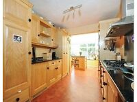 Handbuilt ash kitchen with granite worktops and NEFF appliances
