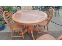 Solid wood extendable round dining table & 4 chairs