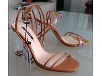 Ladies Transparent Heeled Shoes by Zara.