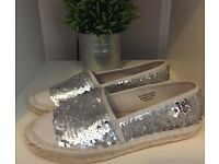 Silver sequinned pumps