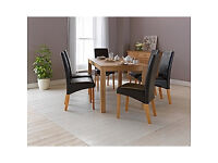 Bromham Oak Dining Table and 6 Chocolate Skirted Chairs