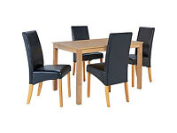 Bromham Oak Dining Table and 4 Black Skirted Chairs.