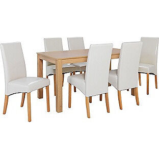 Bromham Oak Dining Table and 6 Cream Skirted Chairs.