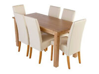 Erin Oak Dining Table and 6 Cream Skirted Chairs.