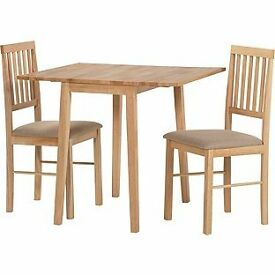 Better than half price, extending dining table and 2 upholstered chairs, as new condition