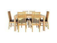 Pemberton Oak Effect Dining Table-6 Black Paris Chairs.