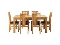 Hemsley Extendable Dining Table & 6 Black Paris Chairs.