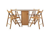 Butterfly Oval Dining Table and 4 Oak Stain Chairs.