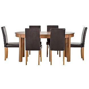 """Woodbury Oval Extendable Table6 Chocolate Chairsin Sheffield, South YorkshireGumtree - Item is flatpacked. please message me for info. """"Table Size H75, L115, W115cm. Size of table extended L166cm. Integral table extension. Solid pine table. Solid pine legs. Chairs 6 chairs. Size of each chair H92, W44, D53cm. Wood frame. Wood legs...."""