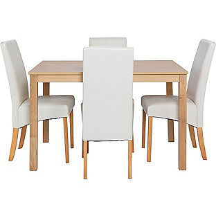 Bromham Oak Dining Table and 4 Cream Skirted Chairs.