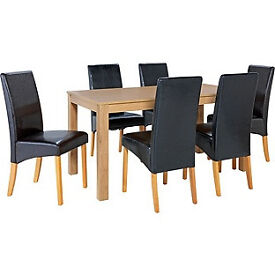 Bromham Oak Dining Table and 6 Black Skirted Chairs.