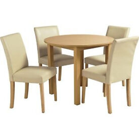 Elmdon Oak Effect Circular Dining Table and 4 Cream Chairs