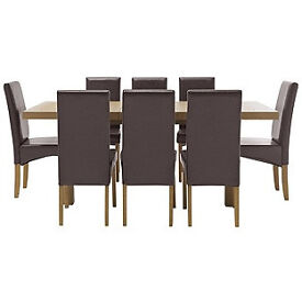 Cosgrove Ext Oak Stain Dining Table and 8 Chocolate Chairs.