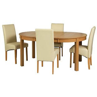 """Massey Wood Effect Extendable Table and 4 Cream Chairsin Bradford, West YorkshireGumtree - New and in original package. Call or text me. """"Table Size H75, L115, W115cm. Size of table extended L166cm. Integral table extension. Wood effect table. Chairs 4 chairs. Size of each chair H95, W44, D56cm. Upholstered frame. Woods legs. PVC seat..."""