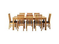 Hemsley Extendable Dining Table & 8 Black Paris Chairs.