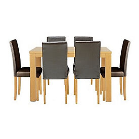 Pemberton Oak Effect Dining Table & 6 Black Chairs.