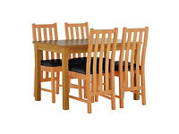 Stanford Oak Effect 120cm Dining Table and 4 Black Chairs