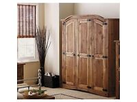 Ex display Large Dark Mexican pine 3 door wardrobe. Less 1/3 shop price as SOLD WHOLE. Delivery.