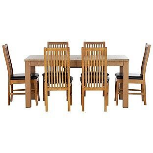 Hemsley Extendable Dining Table and 6 Paris Chairs.
