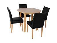 Elmdon Oak Effect Circular Dining Table and 4 Black Chairs