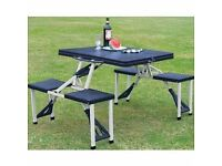 Brand new fold up camping table with 4 stools