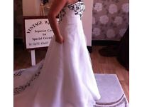 BRAND NEW IVORY & BLACK BEADED STRAPLESS WEDDING DRESS. FITS SIZE 10,12 OR 14