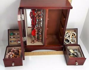 MANY JEWELLERY BOXES FILLED WITH FASHION JEWELLERY