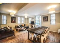 STUNNING CONVERSION 2 BEDROOM APARTMENT IN E14 FULLY OF CHARACTER - IN A FANTASTIC LOCATION