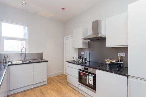 Newly renovated split-level apartment with a stylish living space over first & second floors- SW17