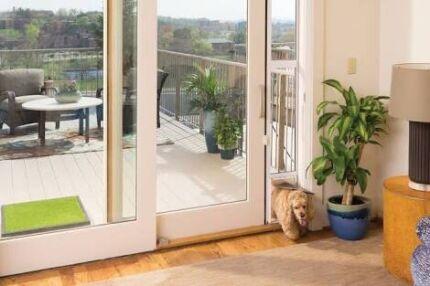 Wanted: Small Patio Lock Pet Door / Dog Door - brand new never used.. grey